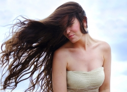 Hair blowing in the wind with dress
